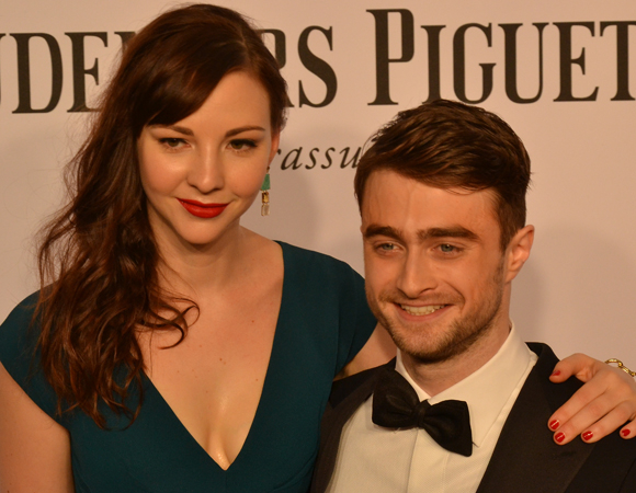 <p><em>Cripple of Inishmaan</em> star Daniel Radcliffe walks the red carpet with date Erin Darke.</p><br />(© David Gordon)