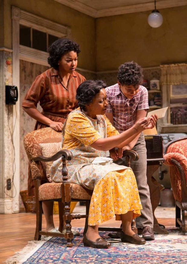 <p>Crystal A. Dickinson, Brenda Pressley, and Owen Tabaka in a scene from <em>A Raisin in the Sun</em>.</p><br />(© T. Charles Erickson)