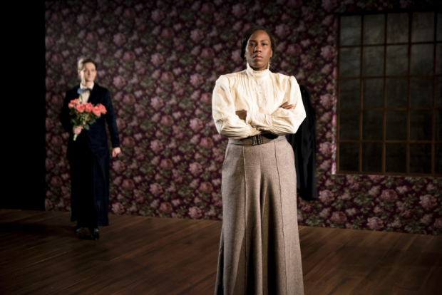 <p>Crystal Lucas-Perry (foreground) takes a defiant stand as Enid Graham (background) holds a bouquet of flowers.</p><br />(© Jenny Anderson)