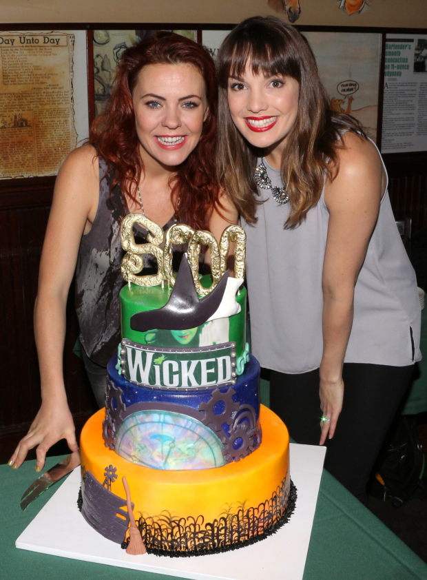 <p>Current <em>Wicked</em> witches Rachel Tucker and Kara Lindsay pose with the show&#39&#x3B;s celebratory 5,000th performance cake.</p><br />(© David Gordon)