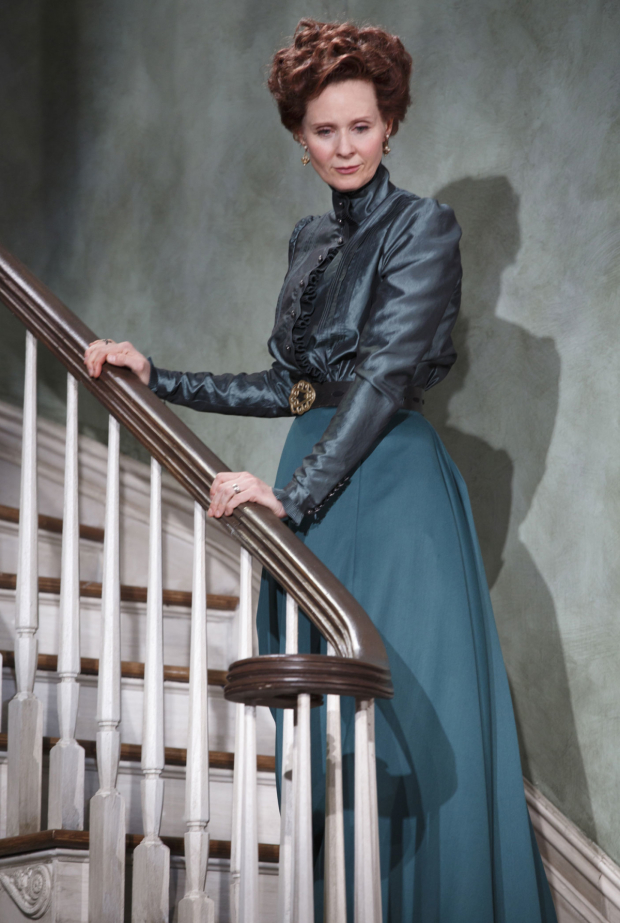 <p>Cynthia Nixon ascends the staircase as Regina.</p><br />(© Joan Marcus)