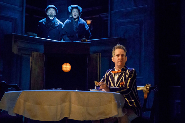 <p>Dan Butler and Opal Alladin play scene behind Tom Hollander.</p><br />(© Joan Marcus)