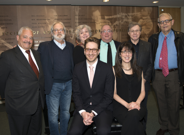 <p>Daniel Goldstein and Stacey Luftig (both seated) are saluted by musical theater writers including John Weidman (second from left), Maury Yeston (second from right), and Richard Maltby Jr. (right).</p><br />(© Allison Stock)