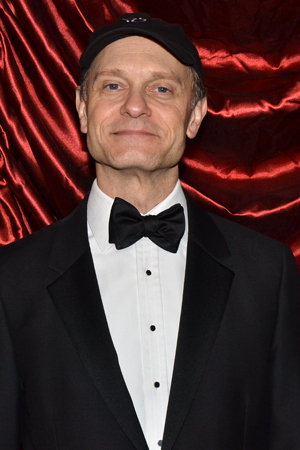 <p>David Hyde Pierce is rocking the rarely seen bowtie/baseball cap combo.</p><br />(© David Gordon)