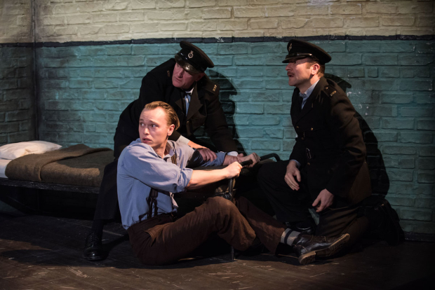<p>David Lansbury, Gilles Geary (seated), and Billy Carter in a scene from <em>Hangmen</em> at Atlantic Theatre Company.</p><br />(© Ahron R. Foster)