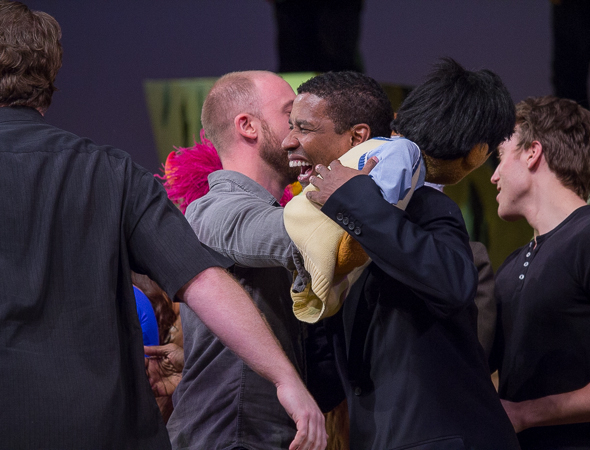<p>Denzel Washington gets a hug from <em>Avenue Q</em>&#39&#x3B;s Princeton.</p><br />(© David Gordon)