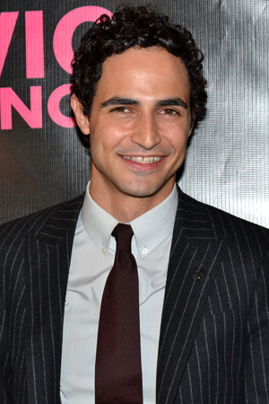 <p>Designer Zac Posen looks fashionable on the red carpet.</p><br />(© David Gordon)