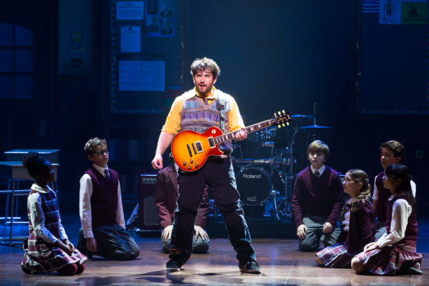 <p>Dewey (Alex Brightman) is a down-on-his-luck musician who cons his way into a private elementary school to teach the kids the finer points of rock and roll.</p><br />(© Matthew Murphy)