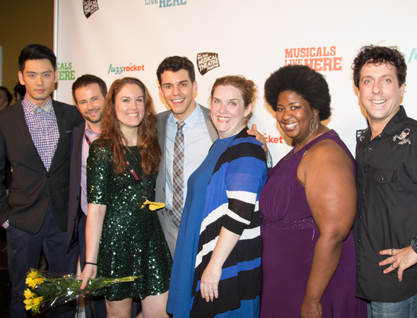 <p>Director Donna Lynne Champlin (center) and the cast of <em>ValueVille</em>.</p><br />(© Seth Walters)