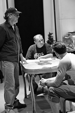 <p>Director Michael Parva stages a scene with Joe Lisi and Jonny Orsini.</p><br />(© Leah Michalos)