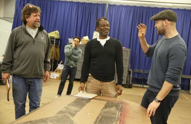 <p>Director Oskar Eustis and stars John Douglas Thompson and Corey Stoll discuss a scene while Christopher Livingston (background) looks on.</p><br />(© Joan Marcus)