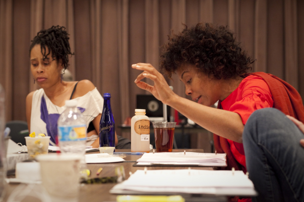 <p>Dominique Morisseau follows along in her script as actress Karen Pittman reads.</p><br />(© Chasi Annexy)
