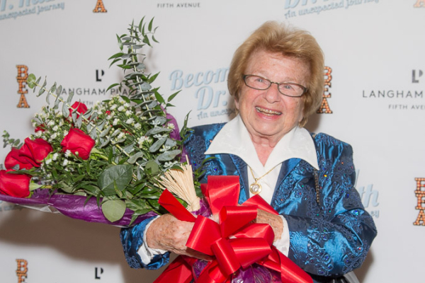 <p>Dr. Ruth admires her beautiful bouquet of roses.</p><br />(© Seth Walters)