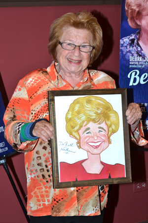 <p>Dr. Ruth shows off her Sardi&#39&#x3B;s caricature.</p><br />(© David Gordon)