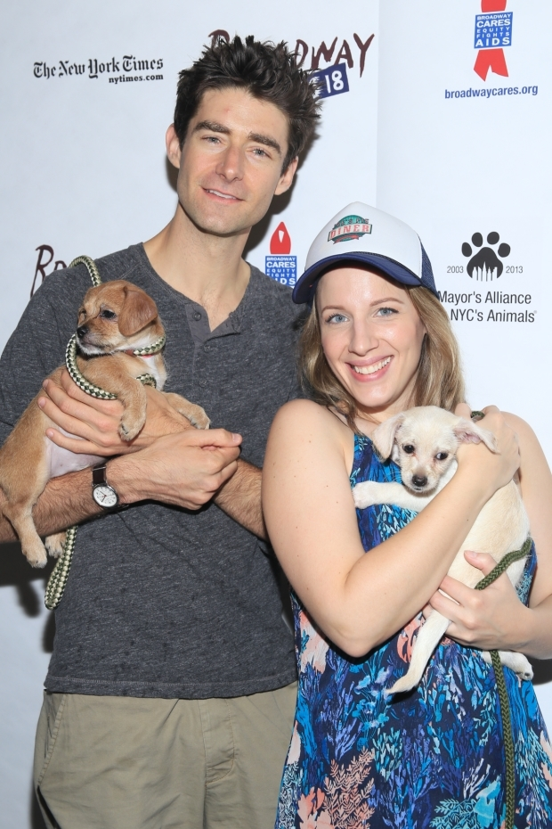 <p>Drew Gehling and Jessie Mueller of <em>Waitress</em> pose with two of the many dogs available for adoption.</p><br />(© Tricia Baron)
