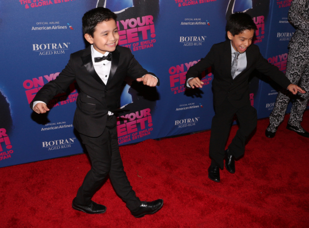 <p>Eduardo Hernandez, who plays Young Emilio, cuts a rug on the red carpet with his understudy, Kevin Tellez.</p><br />(© David Gordon)