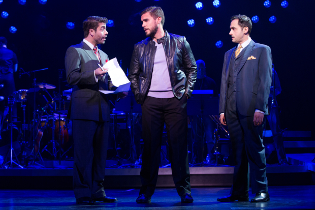 <p>Emilio (Josh Segarra, center) negotiates a huge contract with record executives Warren (Omar Lopez-Cepero, left) and Phil (Lee Zarrett).</p><br />(© Matthew Murphy)