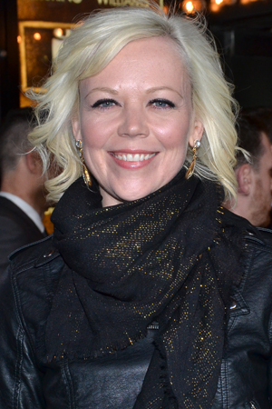 <p>Emily Bergl smiles for the cameras on her way into Studio 54.</p><br />(© David Gordon)