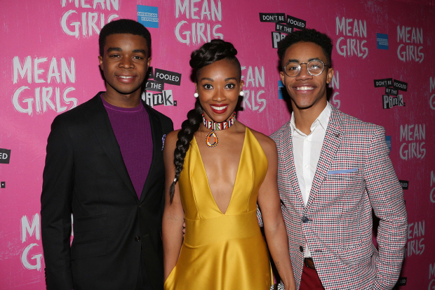<p>Ensemble members Curtis Holland, Kamille Upshaw, and DeMarius R. Copes arrive for the <em>Mean Girls</em> afterparty.</p><br />(© David Gordon)
