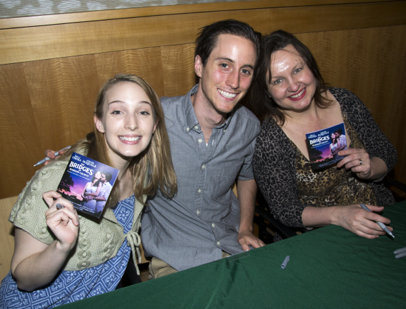 <p>Ephie Aardema, Luke Marinkovich, and Jennifer Allen show off the albums.</p><br />(© David Gordon)