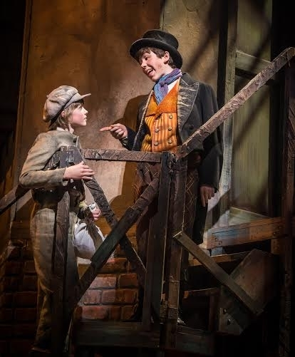 <p>Ethan Haberfield (right) plays the skilled young pickpocket, ArtfulDodger.</p><br />(© Billy Bustamante)
