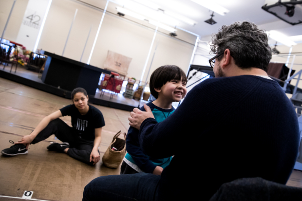 <p>Eva Noblezada (left) looks on as Laurence Connor (right) works with her costar Gregory Ye.</p><br />(© Matthew Murphy)