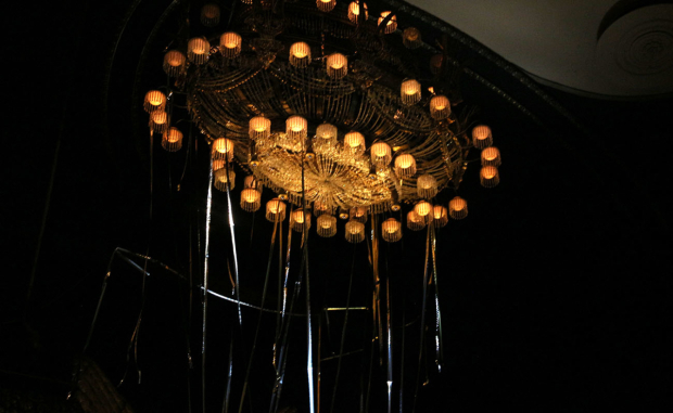 <p>Even the famed chandelier wears some confetti for the anniversary celebration.</p><br />(© David Gordon)