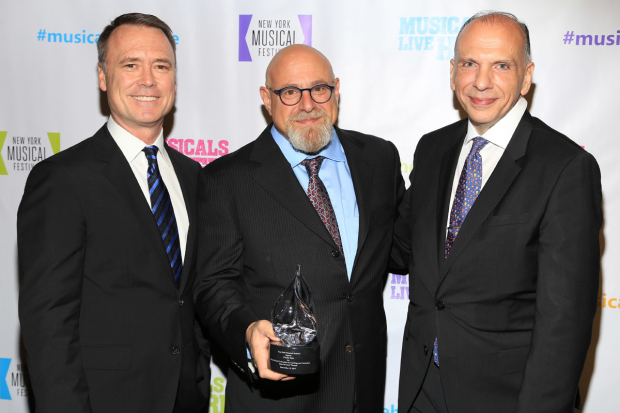 <p>Executive director and producer Dan Markley (left) and board member Frank Troutman (right) celebrate with honoree Charles Fink. </p><br />(© Tricia Baron)