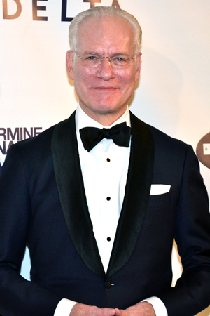 <p>Fashion guru Tim Gunn shows off his style on the red carpet.</p><br />(© David Gordon)