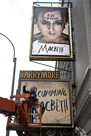 <p>February 12: Alan Cumming helps install the signage for his production of <em>Macbeth</em> at the Ethel Barrymore Theatre. The mounting featured Cumming as a psych-ward patient who reenacts Shakespeare's supernatural tragedy all by himself, while a doctor and orderly monitor his behavior.</p><br />(© David Gordon)