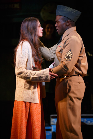<p>Flick (Joshua Henry) feels very protective of Violet (Sutton Foster).</p><br />(© Joan Marcus)