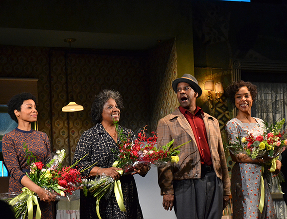 <p>Flowers in hand, the stars of <em>A Raisin in the Sun</em> take in the audience&#39&#x3B;s applause.</p><br />(© David Gordon)