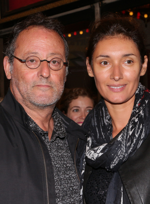 <p>French actor Jean Reno takes in the show with his wife, actress Zofia Borucka.</p><br />(© David Gordon)