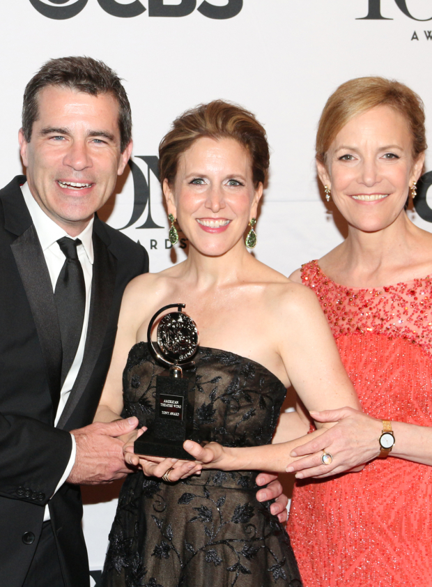 <p><em>Fun Home</em> producers Mike Isaacson, Kristin Caskey, and Barbara Whitman are victorious with tier Best Musical trophy.</p><br />(© David Gordon)
