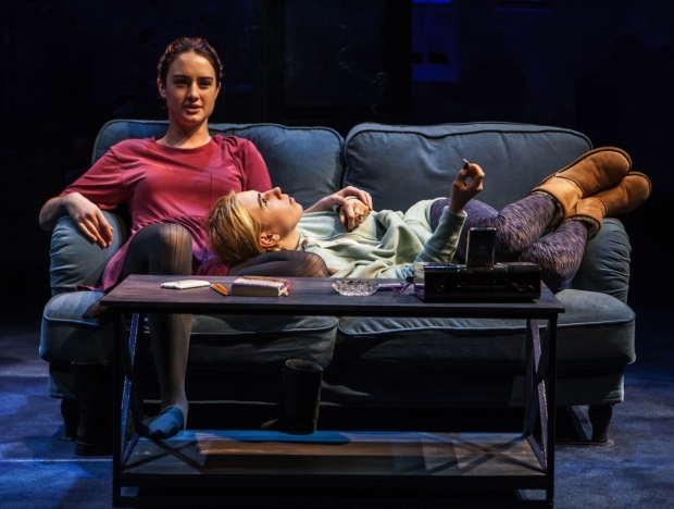 <p>Grace Van Patten and Zosia Mamet get comfortable in a scene from <em>The Whirligig</em>.</p><br />(© Monique Carbon)