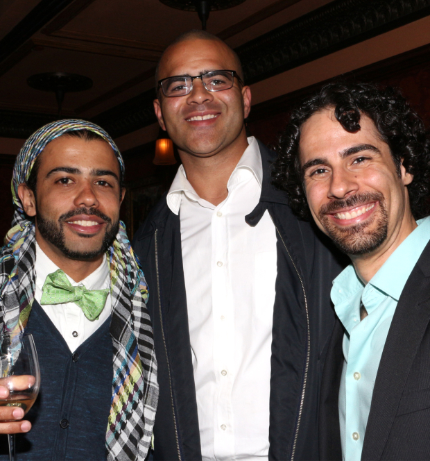 <p><em>Hamilton</em> cast members Daveed Diggs and Christopher Jackson toast the show&#39&#x3B;s win with musical director Alex Lacamoire.</p><br />(© David Gordon)