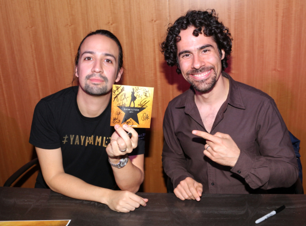 <p><em>Hamilton</em> music makers Lin-Manuel Miranda and Alex Lacamoire show off their CD booklet.</p><br />(© David Gordon)