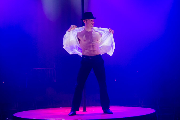 <p>Hamish McCann shows his bod off to the audience.</p><br />(© Seth Walters)