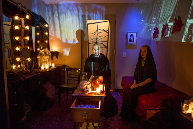 <p>Hoon Lee and Genevieve White welcome trick-or-treaters into a scarily transformed dressing room.</p><br />(&copy&#x3B; Jeremy Daniel)
