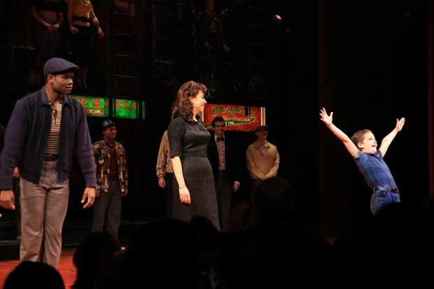 <p>Hudson Loverro (right) enjoys his opening-night ovation as Young Calogero.</p><br />(© @Tricia Baron 2016)