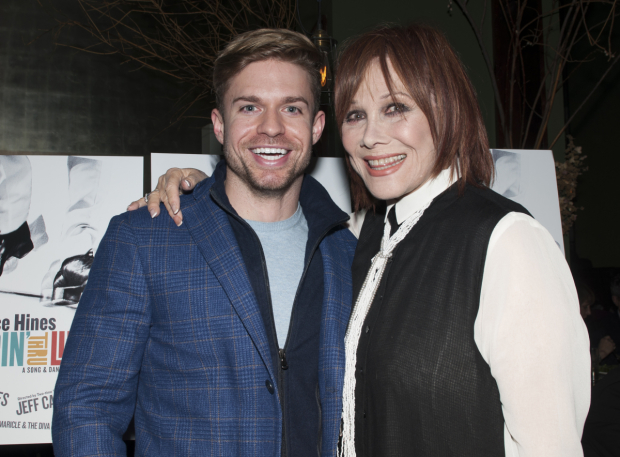 <p>Hunter Ryan Herdlicka and Michele Lee walk the red carpet at the after-party.</p><br />(© Allison Stock)