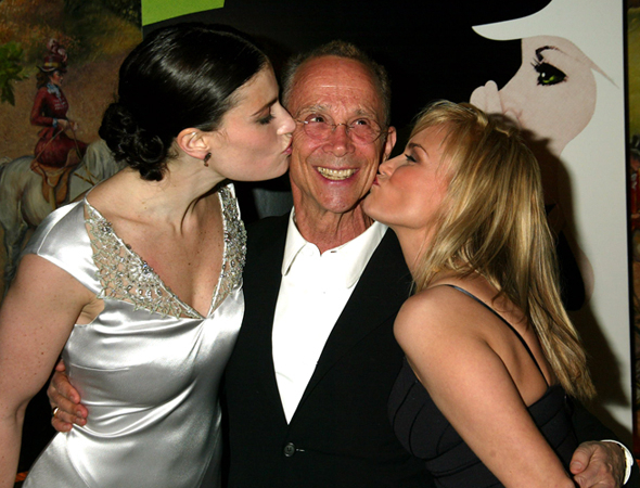 <p>Idina Menzel and Kristin Chenoweth plant juicy kisses on the cheek of their Wizard, Joel Grey.</p><br />(© Joseph Marzullo)