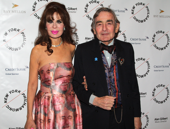 <p>In the evening&#39&#x3B;s most inspired outfit, interior decorator Gail Maidman (seen here with her husband, lawyer Richard H.M. Maidman) wears a dress featuring Stephen Sondheim&#39&#x3B;s face.</p><br />(© David Gordon)