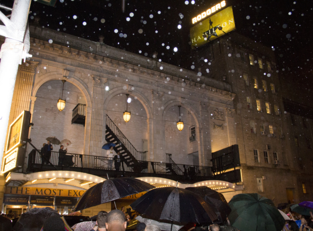 <p>In the pouring rain, Miranda steps up to the balcony of the Richard Rodgers Theatre.</p><br />(© David Gordon)
