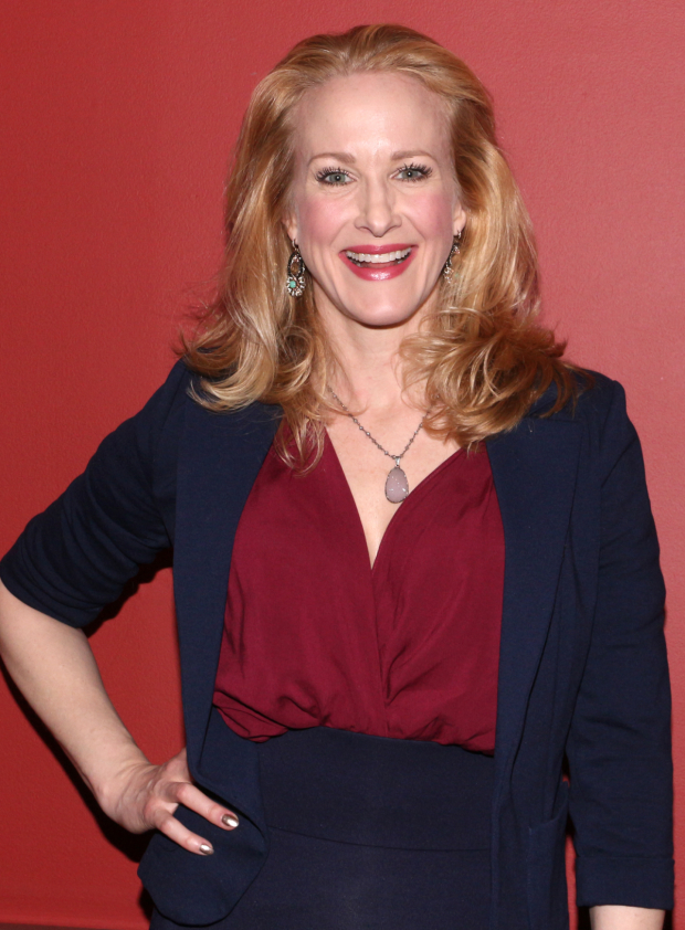 <p><em>It&#39&#x3B;s Only a Play</em> star Katie Finneran smiles for the cameras before presenting Outer Critics Circle Awards.</p><br />(© David Gordon)
