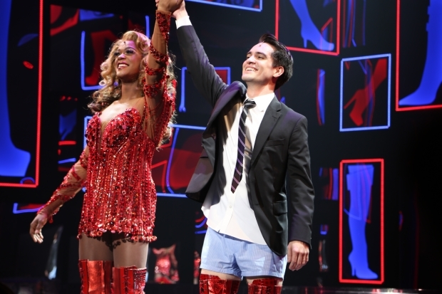 <p>J. Harrison Ghee and Brendon Urie take a triumphant bow at curtain call.</p><br />(© Tricia Baron)