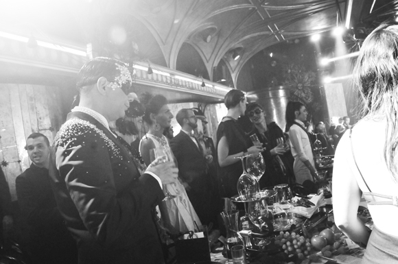 <p>James Aguiar, Giovanna Battaglia, and guests enjoy the spread at <em>Queen of the Night</em>.</p><br />(© Jenny Anderson)