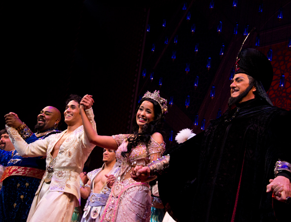 <p>James Monroe Iglehart, Adam Jacobs, Courtney Reed, and Jonathan Freeman bow on the opening night of <em>Aladdin</em>.</p><br />(© David Gordon)