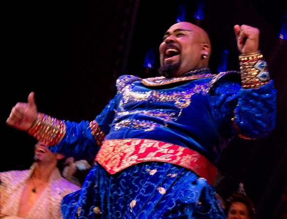 <p>James Monroe Iglehart jumps up and down with excitement.</p><br />(© David Gordon)