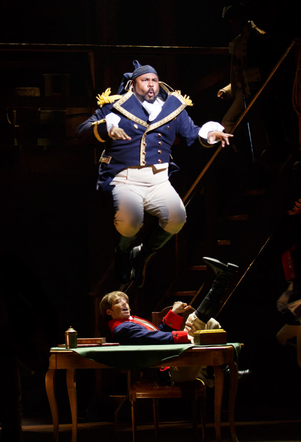 <p>James Monroe Iglehart leaps into his role as Lafayette.</p><br />(© Joan Marcus)